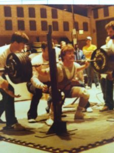 Doug Holland squatting in 1983