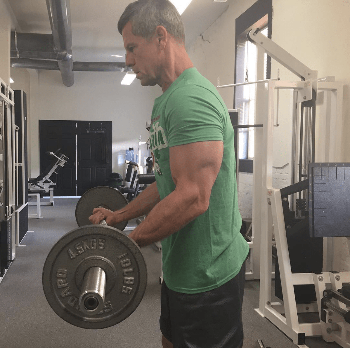 Dr Doug McGuff doing barbell curls